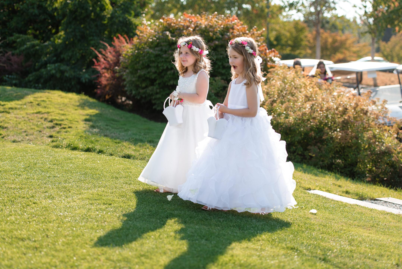 Flower Girls Walk Down Aisle at Wedding Ceremony