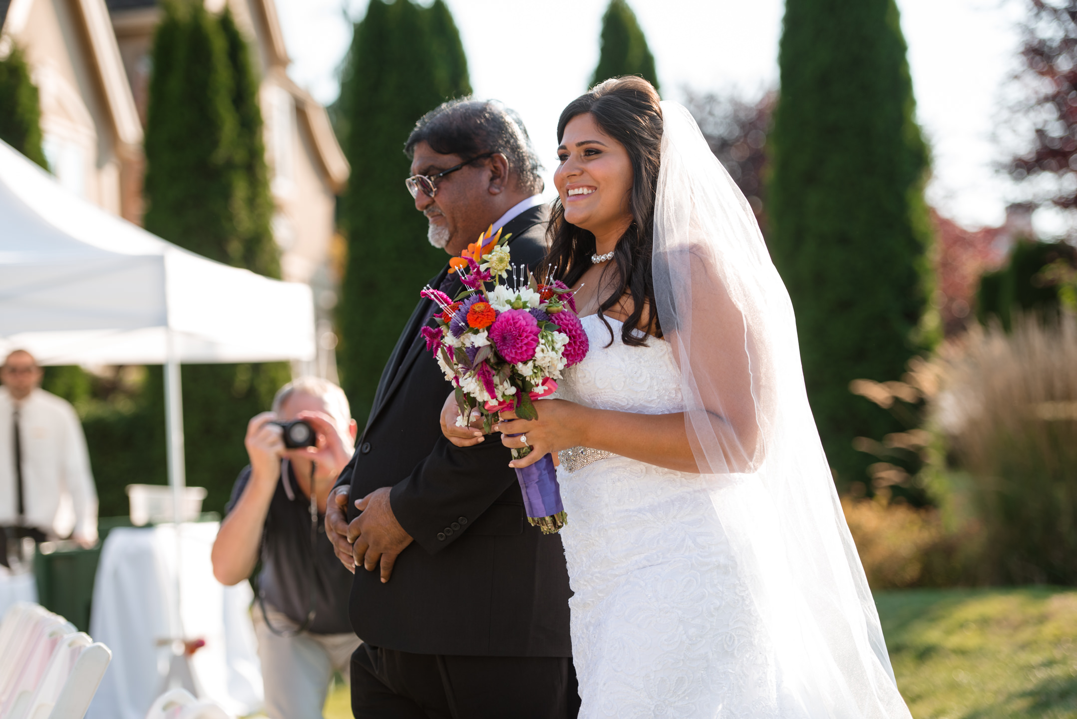 Father and Indian Bride Happy Walk Down Aisle during Wedding Ceremony