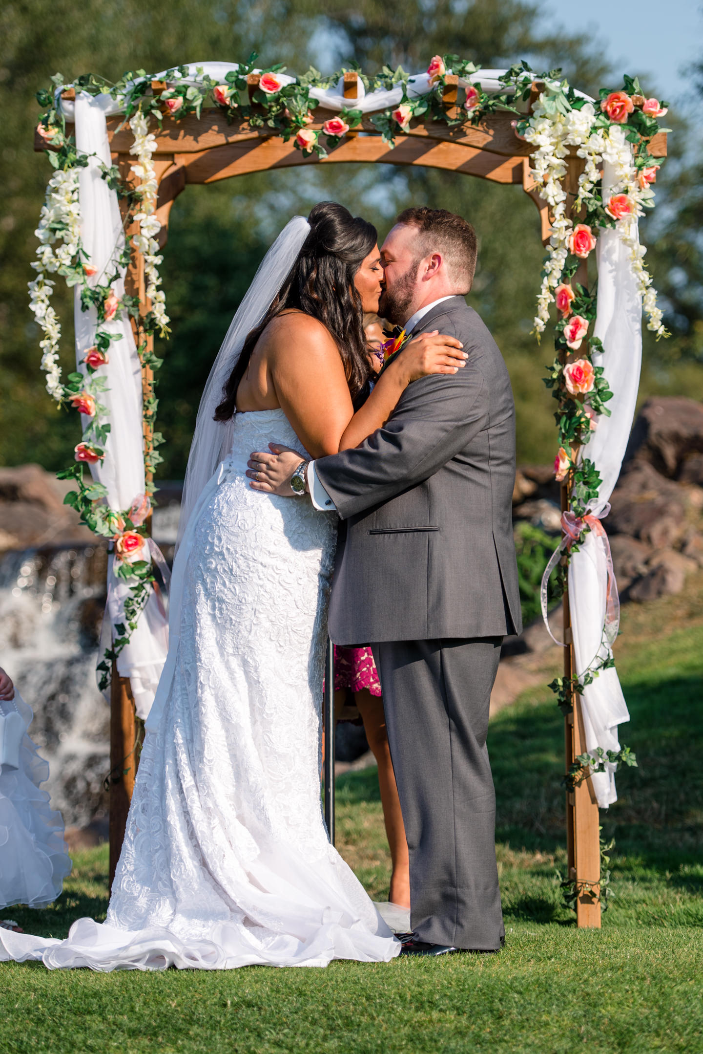 Indian Bride and Groom Kiss during Wedding Ceremony
