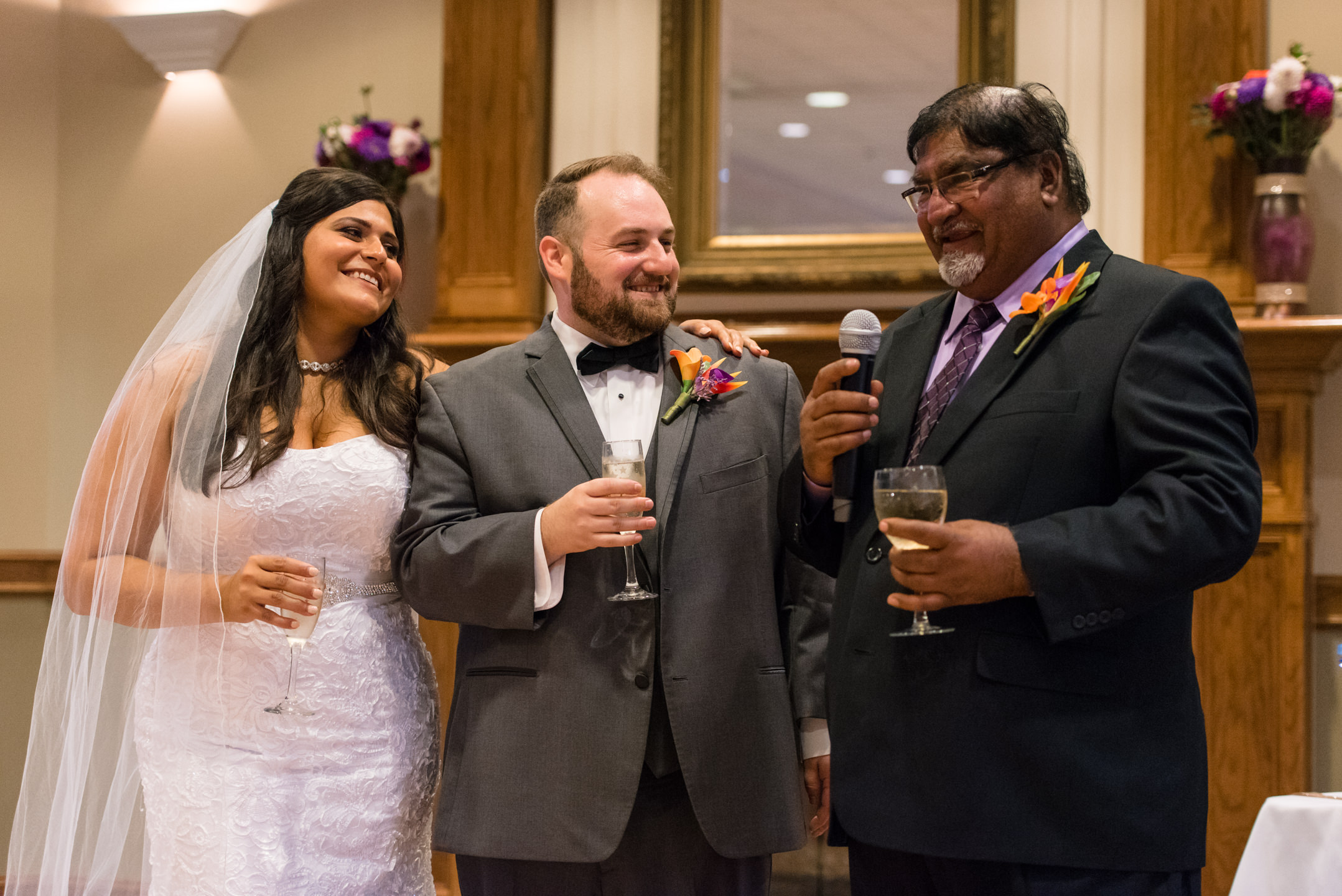 Bride and Groom Laugh during Indian Father's Wedding Toast