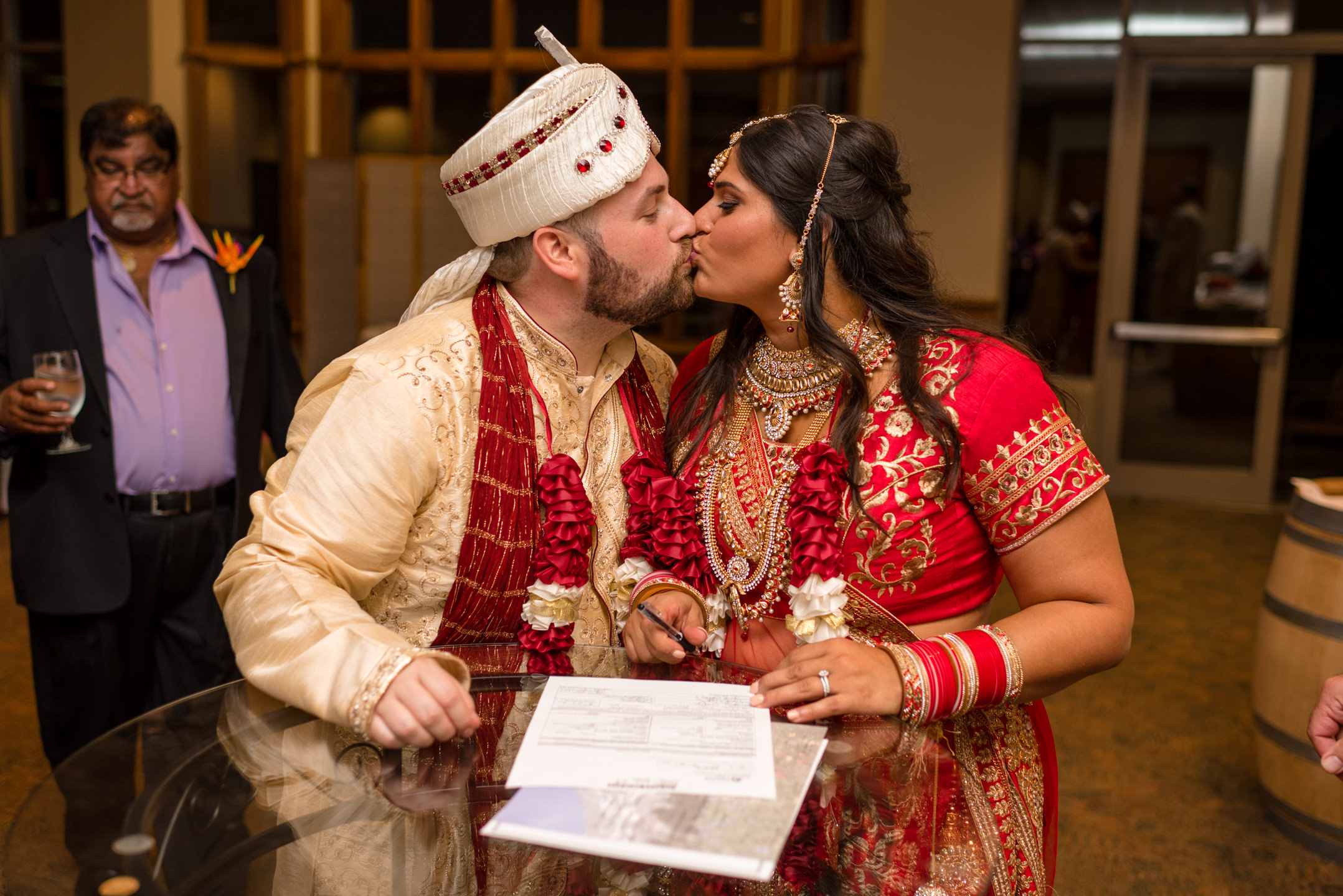 Indian Bride and Groom Happy Signing Marriage Certificate