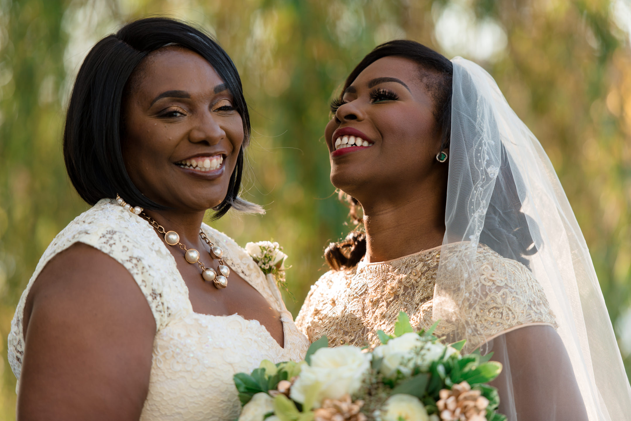 Bride and Mother Laugh During Family Portraits