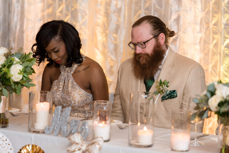 Bride and Groom Praying Before Wedding Dinner