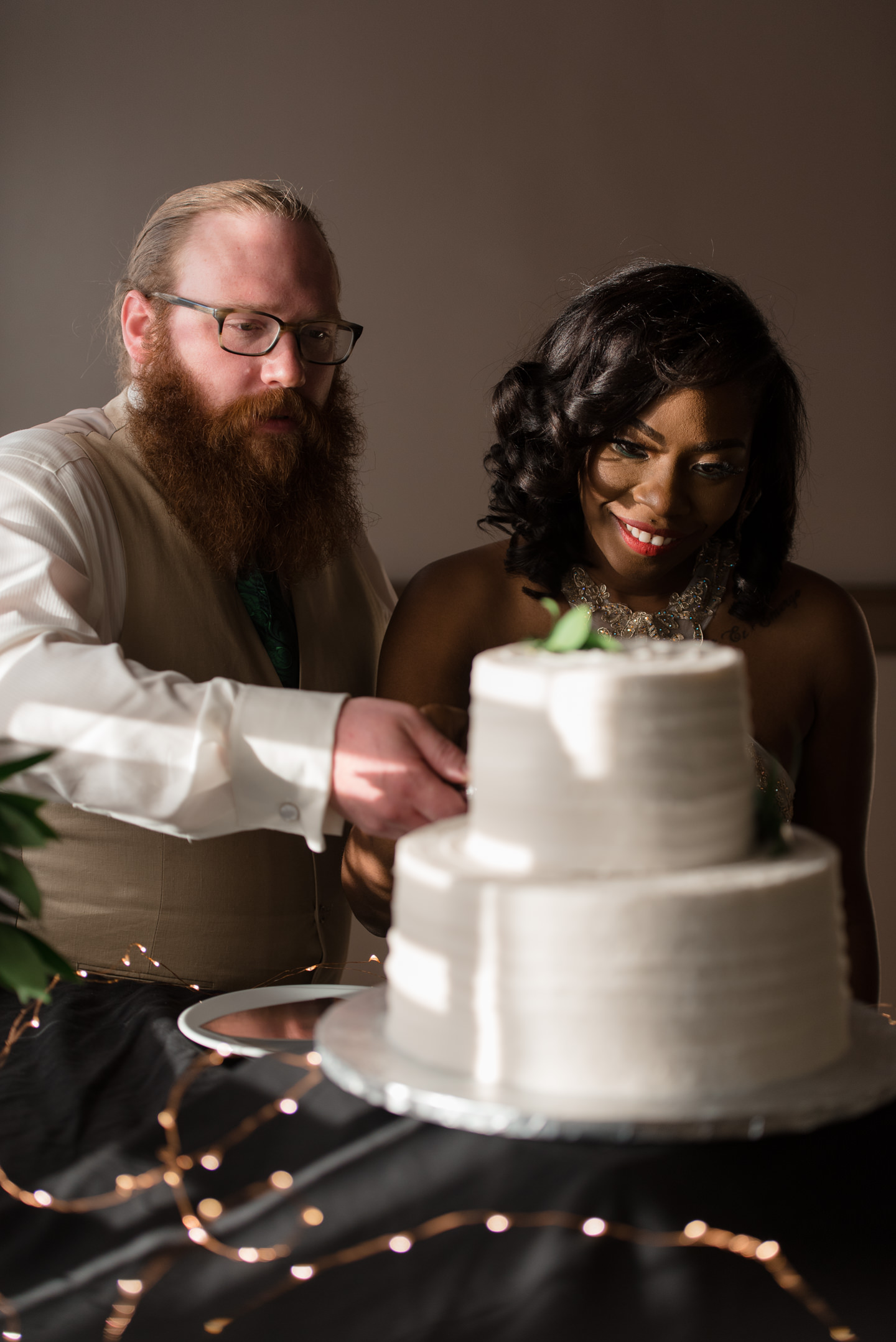 Bride and Groom Cut Their Cake at Tyee Yacht Club