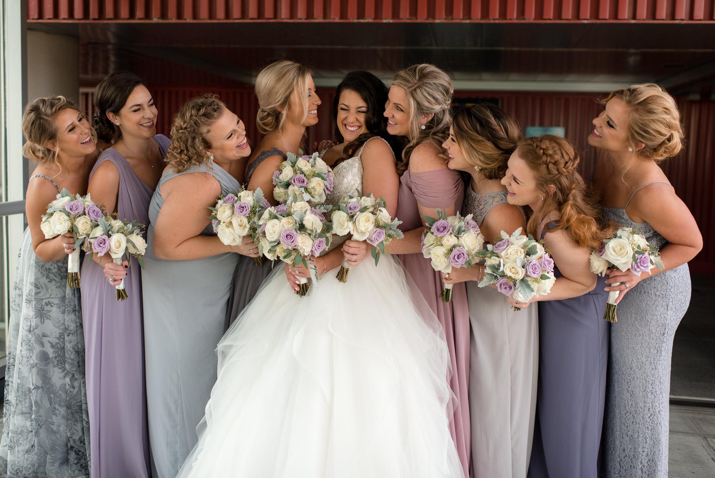 Bride and Bridesmaids Laughing and Having Fun