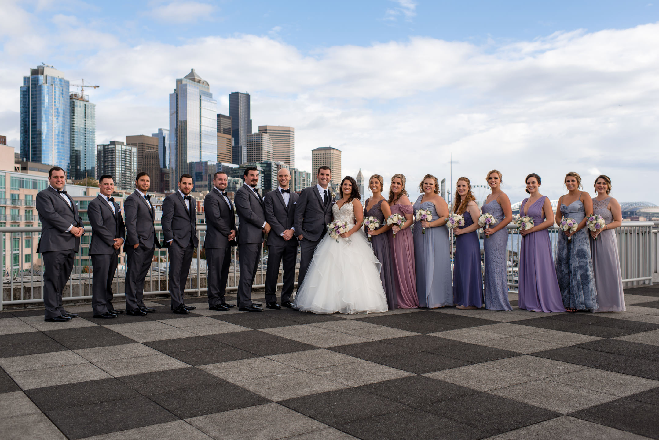 Bride and Groom Seattle Waterfront Skyline Wedding Party Portrai