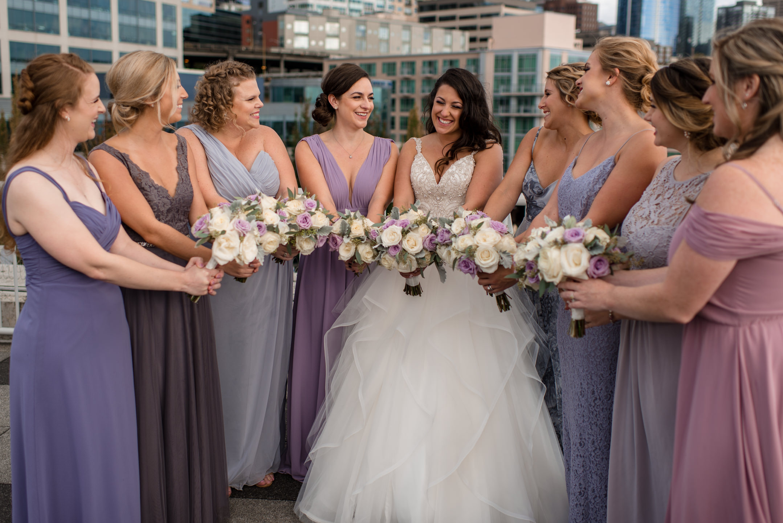 Bride and Bridesmaids Show Flowers Wedding Portrait