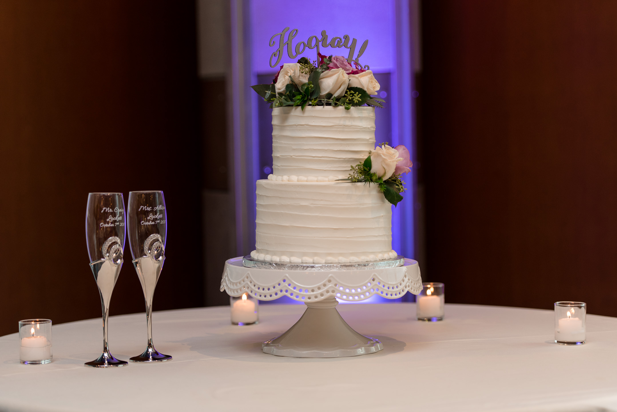 Cake and Champagne Glasses Wedding Details at Bell Harbor