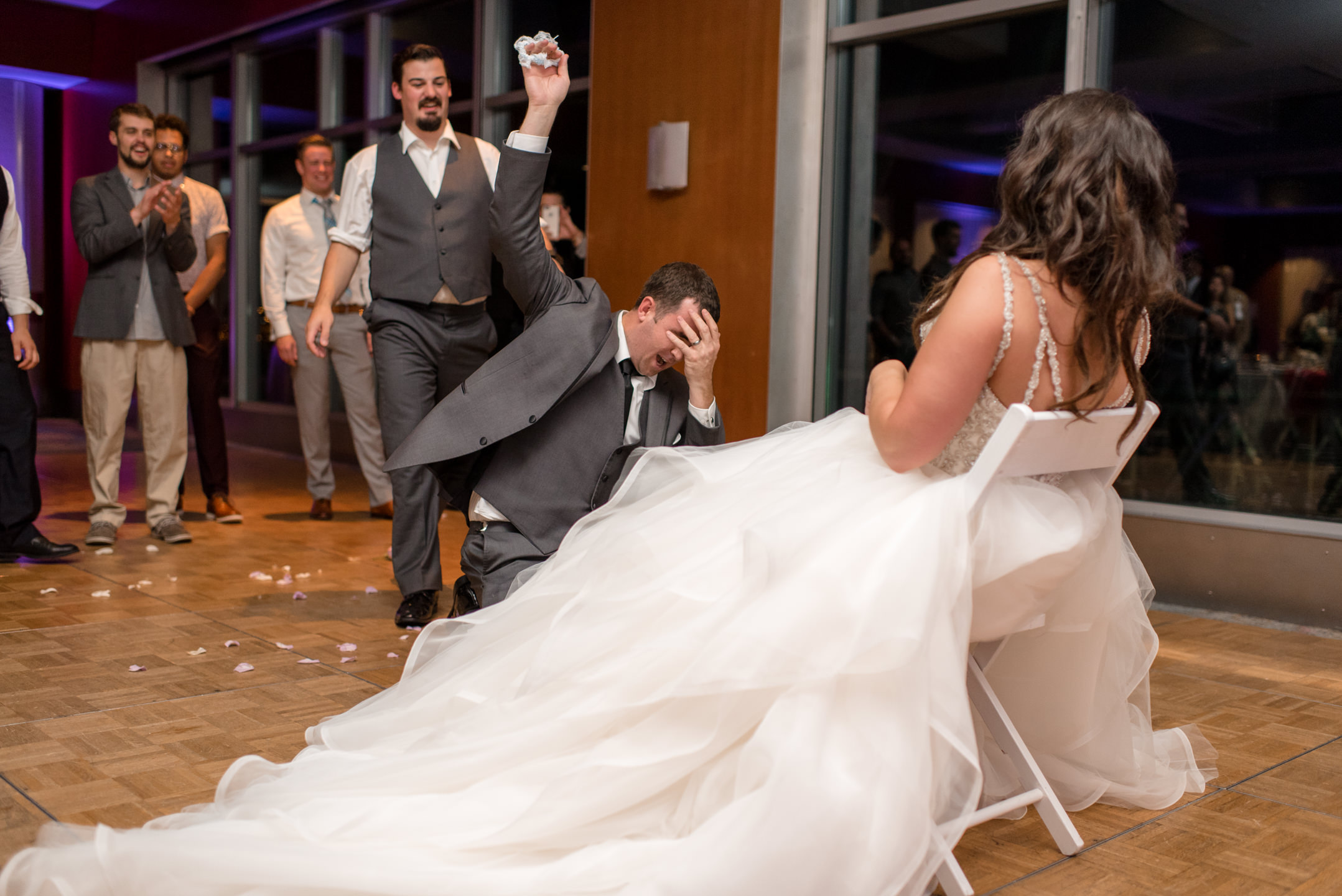 Bride and Groom Hilarious Garter Toss at Bell Harbor