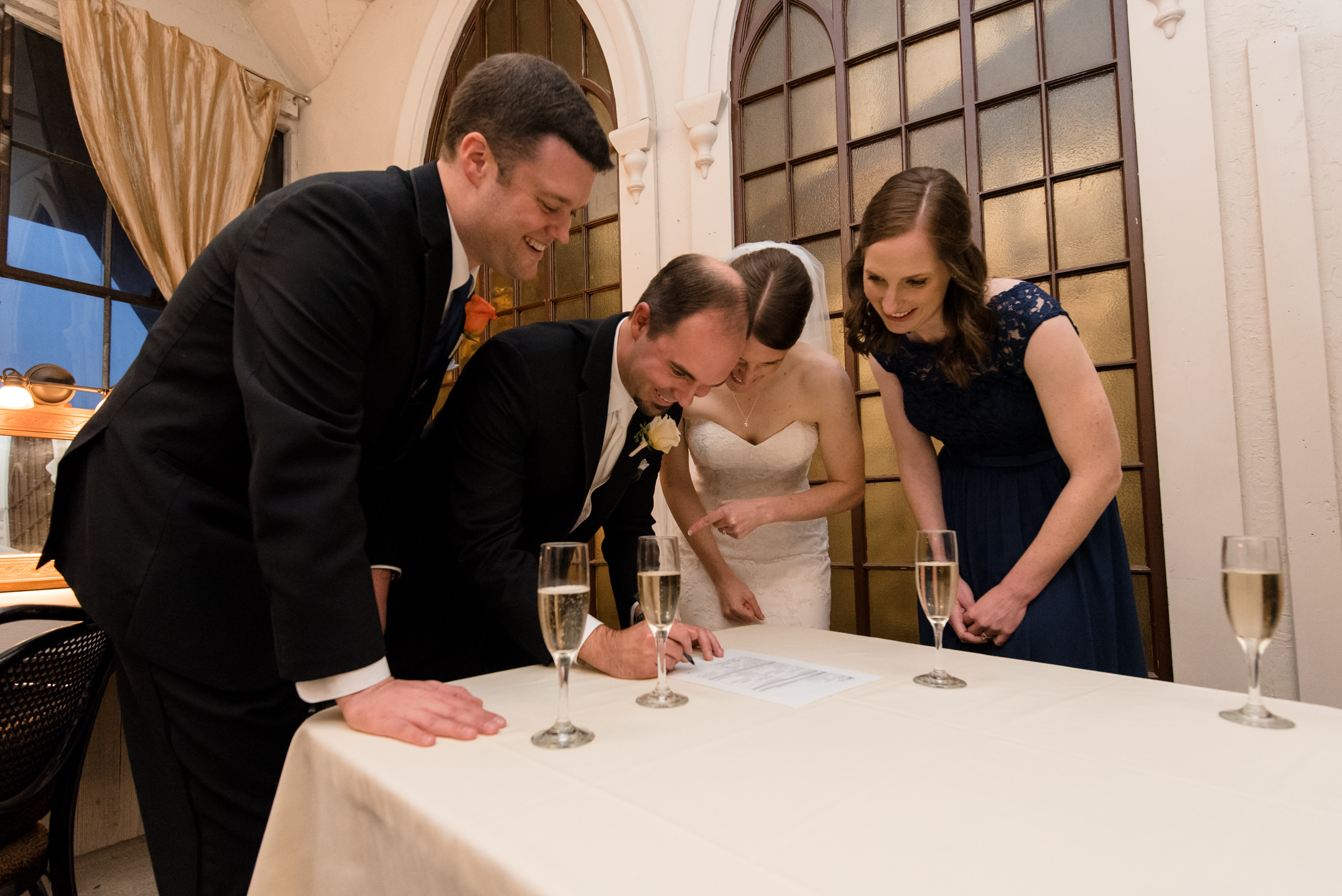 Bride and Groom Sign Marriage Certificate at Lake Union Cafe