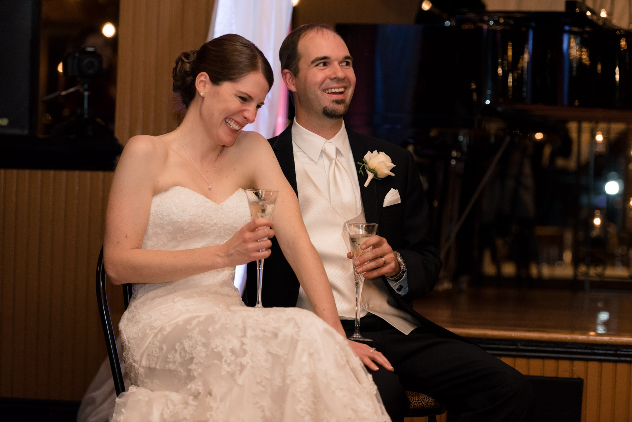 Bride and Groom Listen to Wedding Toasts at Lake Union Cafe