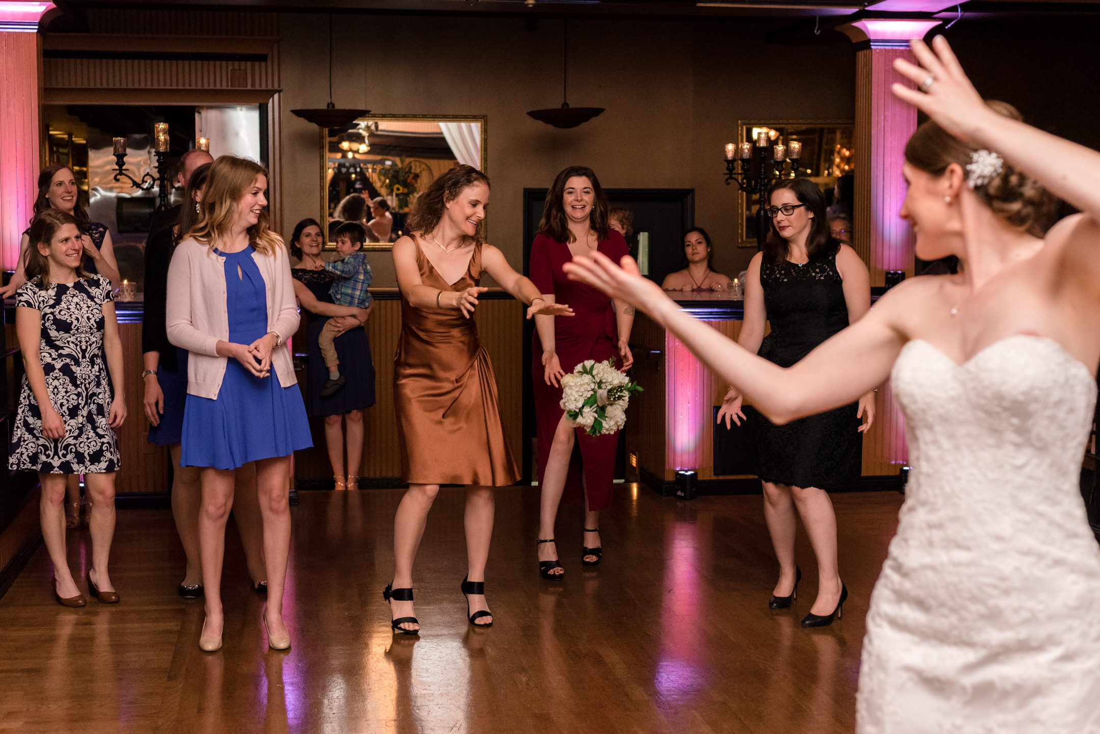 Bride Tosses Bouquet During Wedding at Lake Union Cafe