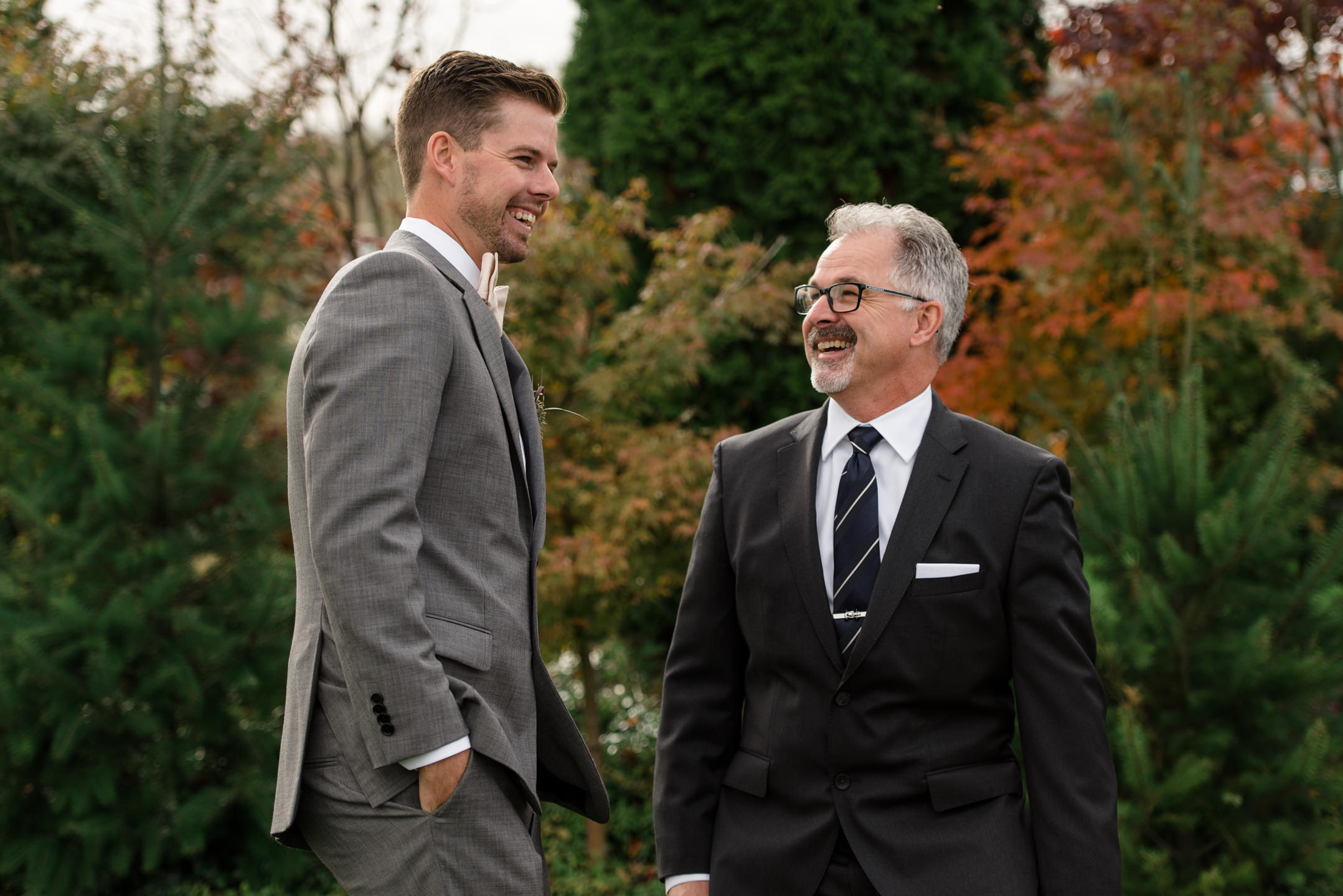Groom and Father Happy Laugh during Family Portraits