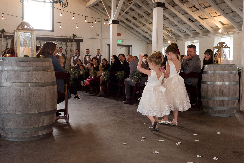 Flower Girls Walk down Aisle during Wedding Ceremony