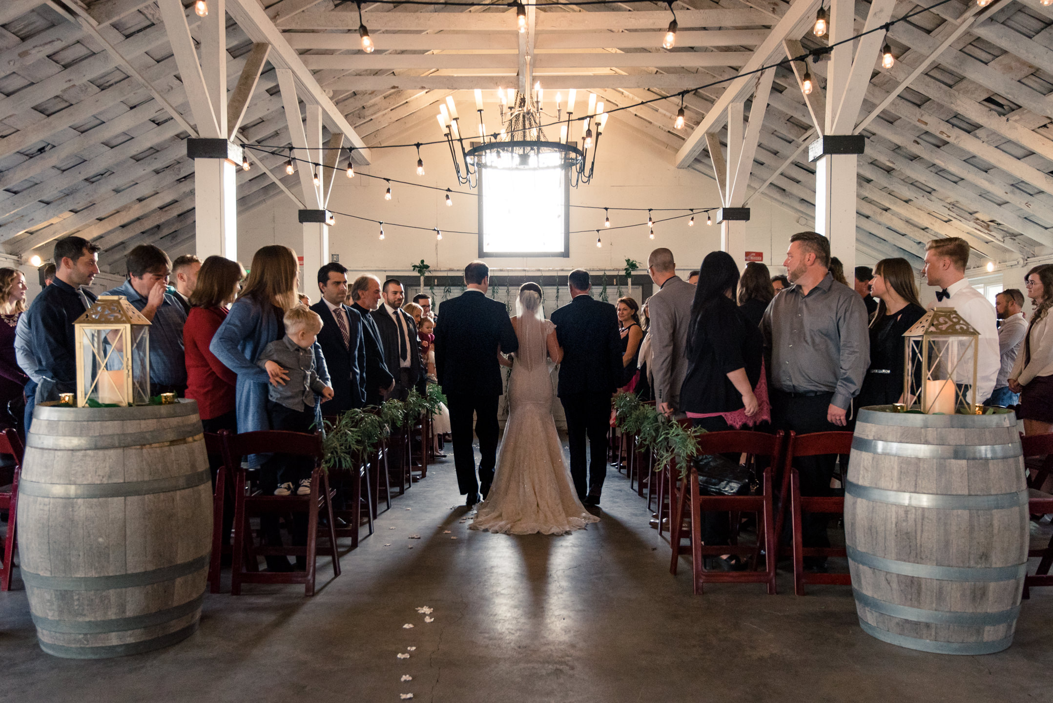 Bride and Fathers Walk down Aisle during Wedding Ceremony