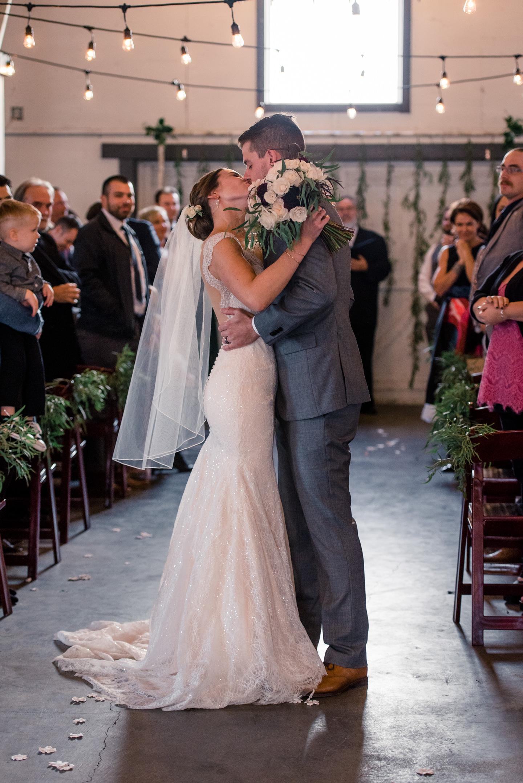 Bride and Groom Wedding Ceremony Kiss