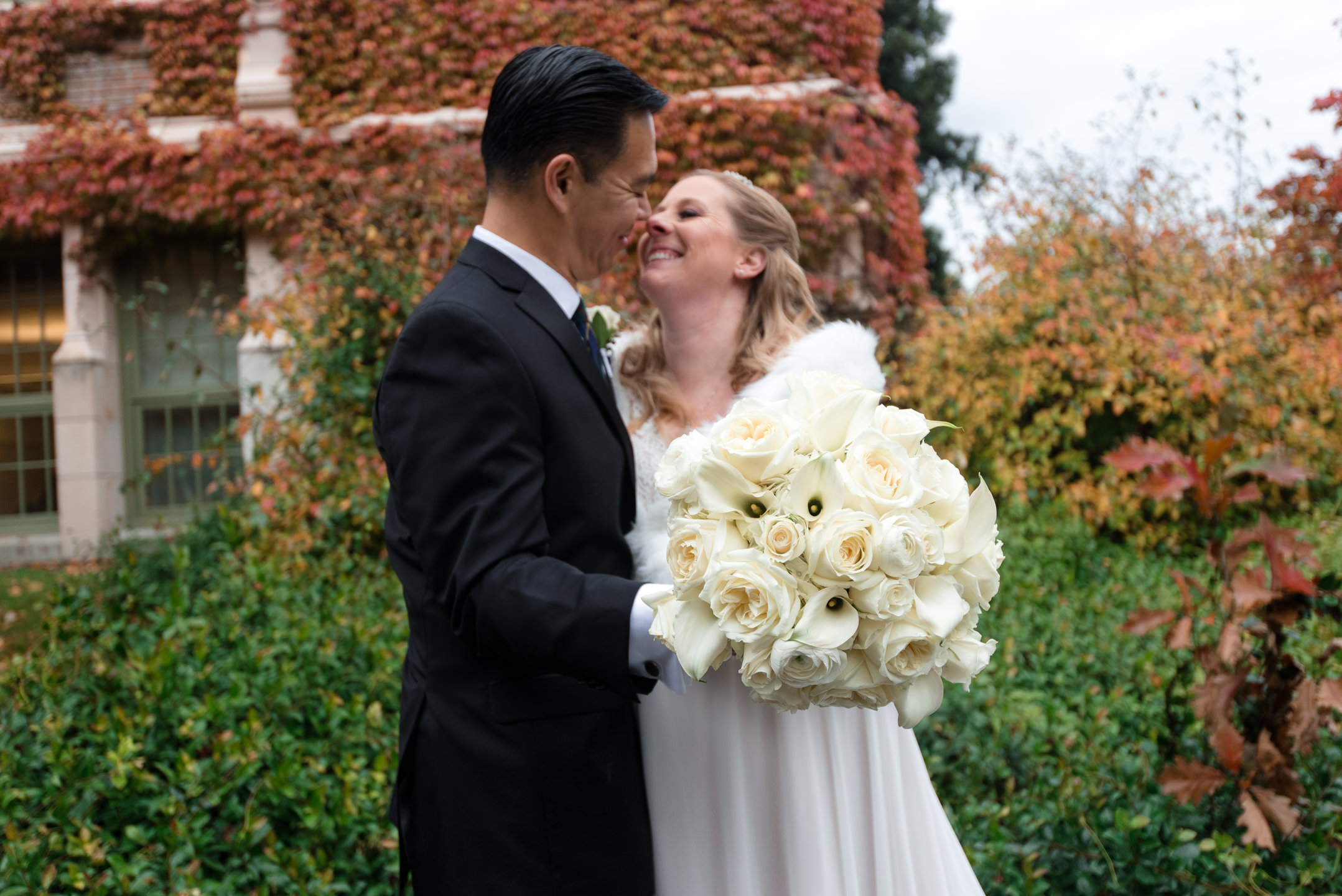 Bride and Asian Groom Wedding Bouquet Portrait at the University
