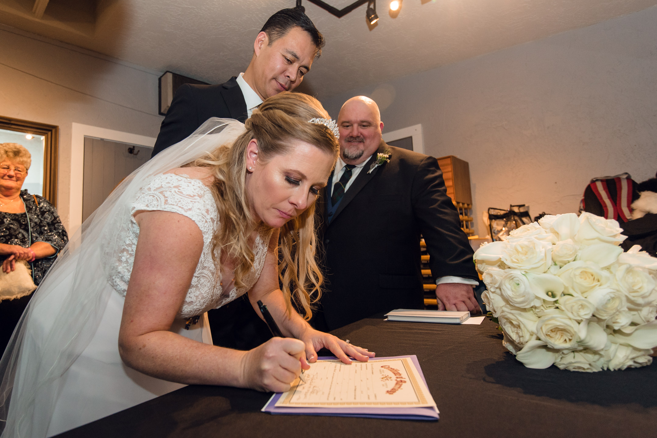 Bride and Asian Groom Wedding Certificate Signing