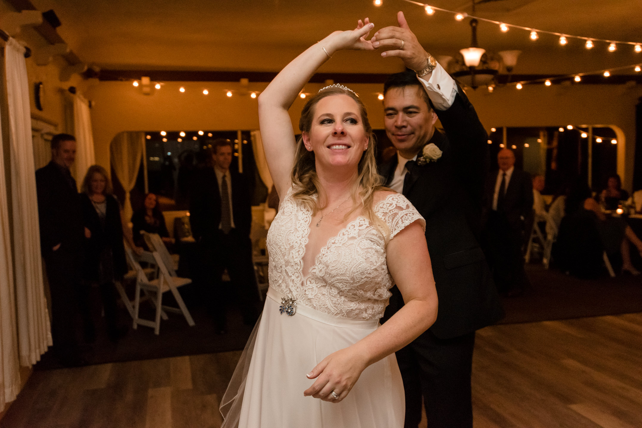 Bride and Asian Groom Dance during Wedding Reception