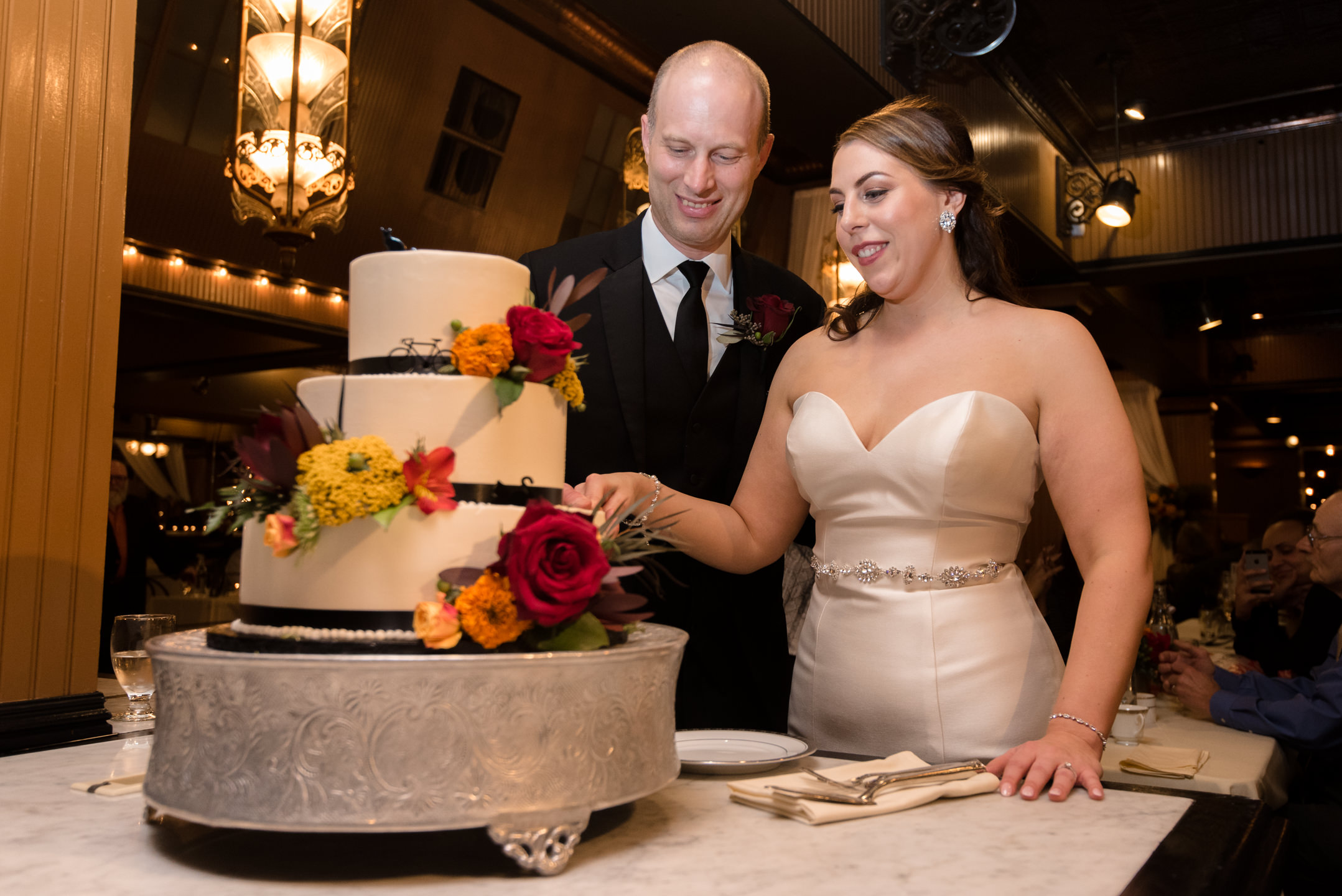 Bride and Groom Cake Cutting at Lake Union Cafe