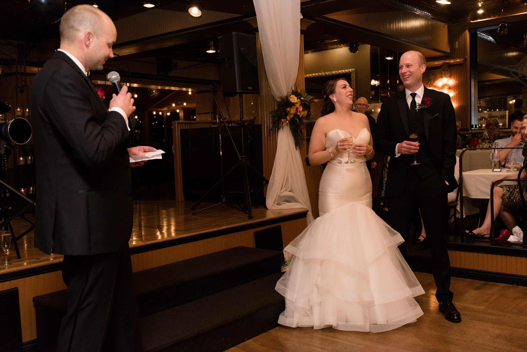 Bride and Groom Listen to Wedding Toast at Lake Union Cafe