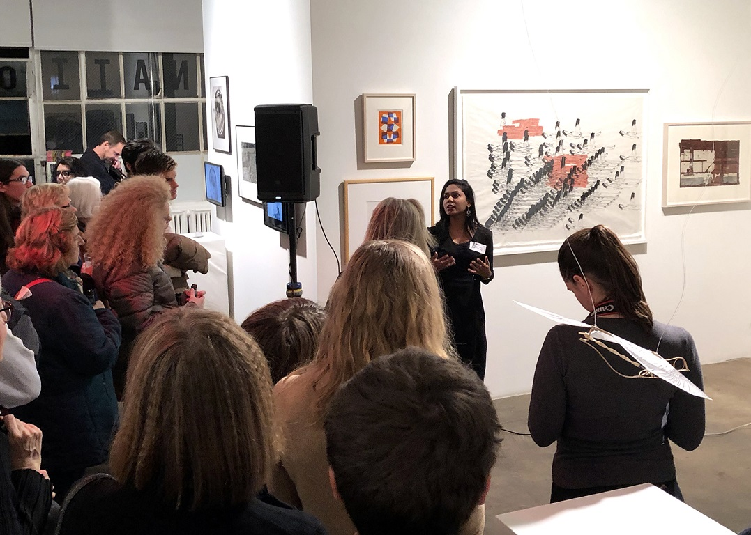 Shivangi giving an artist talk in front of her work as part of  Edging Forward: New Prints 2018/Winter .