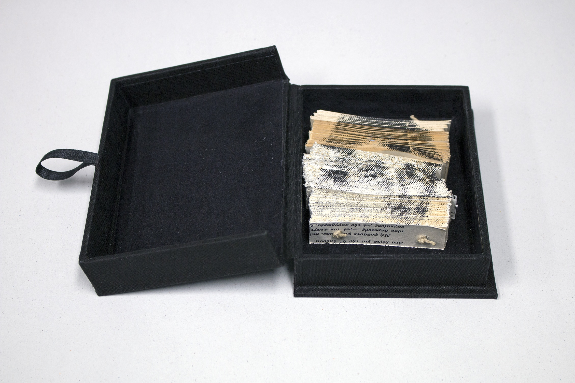 Ioannis Anastasiou   Kinotaphio  from the series  Koinotaphia (Common Graves) ,   2019 Artist book: Screenprint on book-objects created from hacked books, artist made box, and zinc label Box: 5 7/8 x 4 3/8 x 1 1/8 inches (closed) Printed and published by the artist Edition: Unique  Courtesy of the artist