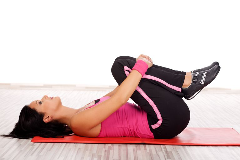 Back Stretch + Gas Release   Hold position for 15 seconds and then rest your legs flat on the ground. Rest for 5 seconds. Do 4 sets of this exercise.