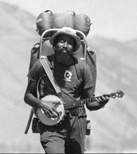 John Francis and his banjo on one of his many walks across the states.