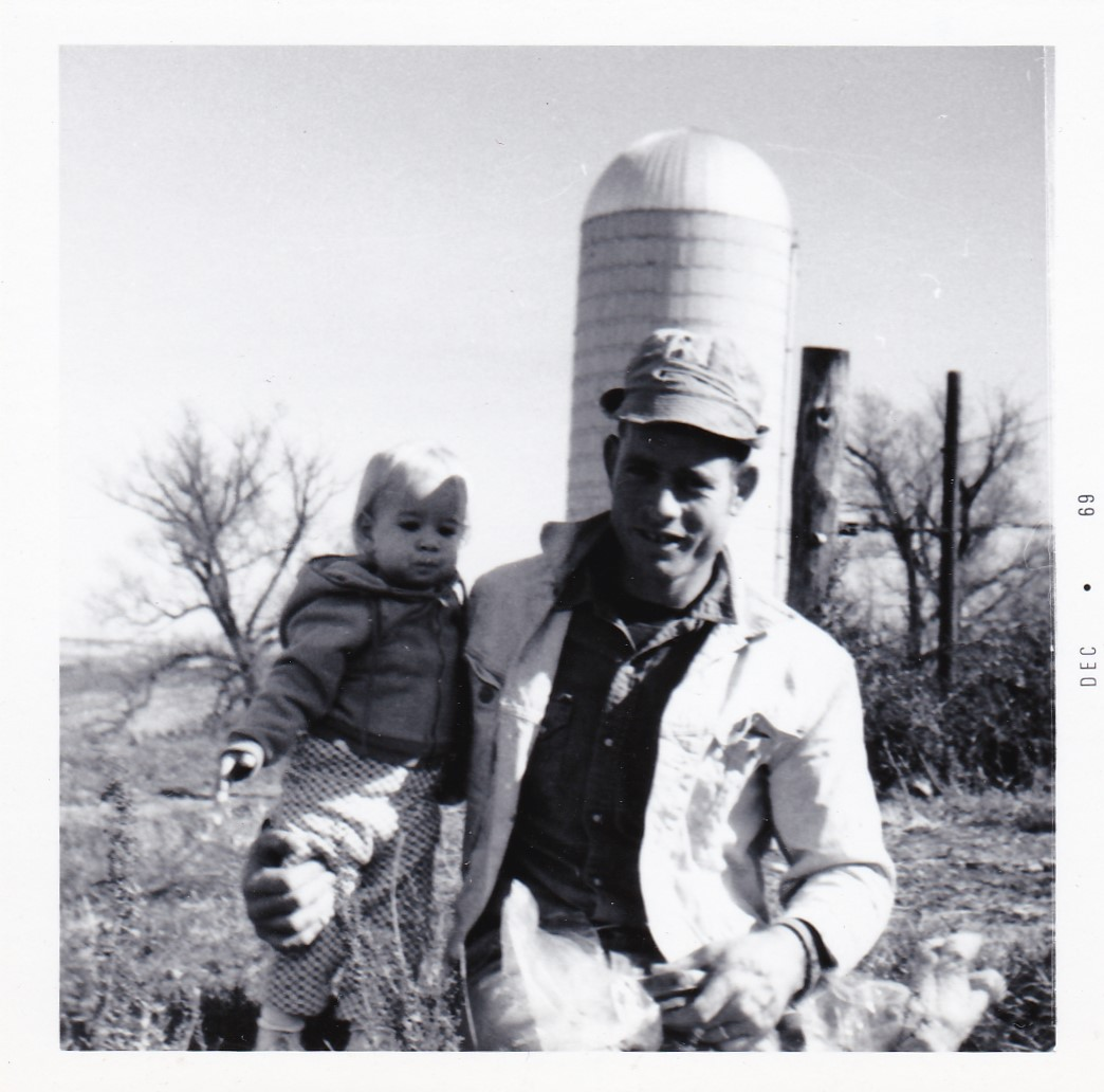 with Dad on farm.jpg