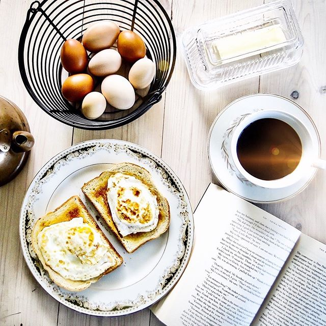"""""""On a misty Monday morning it was the small, comforting things, like collecting fresh eggs from the coop and reading while they fried, spatula in one hand paperback in the other."""" ⠀ ⠀ ⠀ #monday #slowliving #bibliophile"""