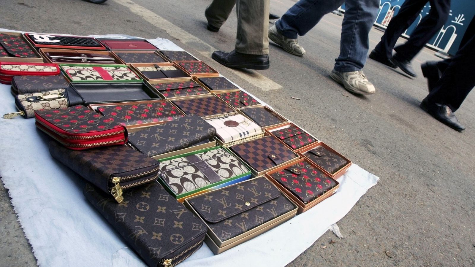 Some people may think that counterfeiting could be good for fashion. We don't. // Image:AP / Greg Baker