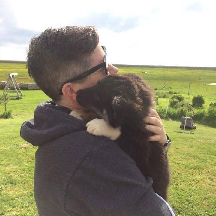 Jen K. Hughes and Icelandic puppy on Stokkseyrarsel farm, South Iceland 2016. Photo Credit: Margit Barna