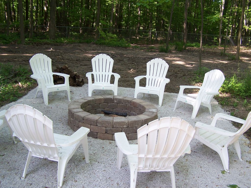 Backyard has firepit