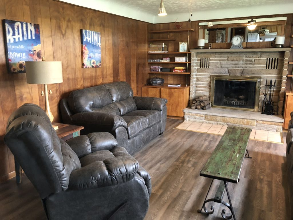 Living room features a wood burning fireplace
