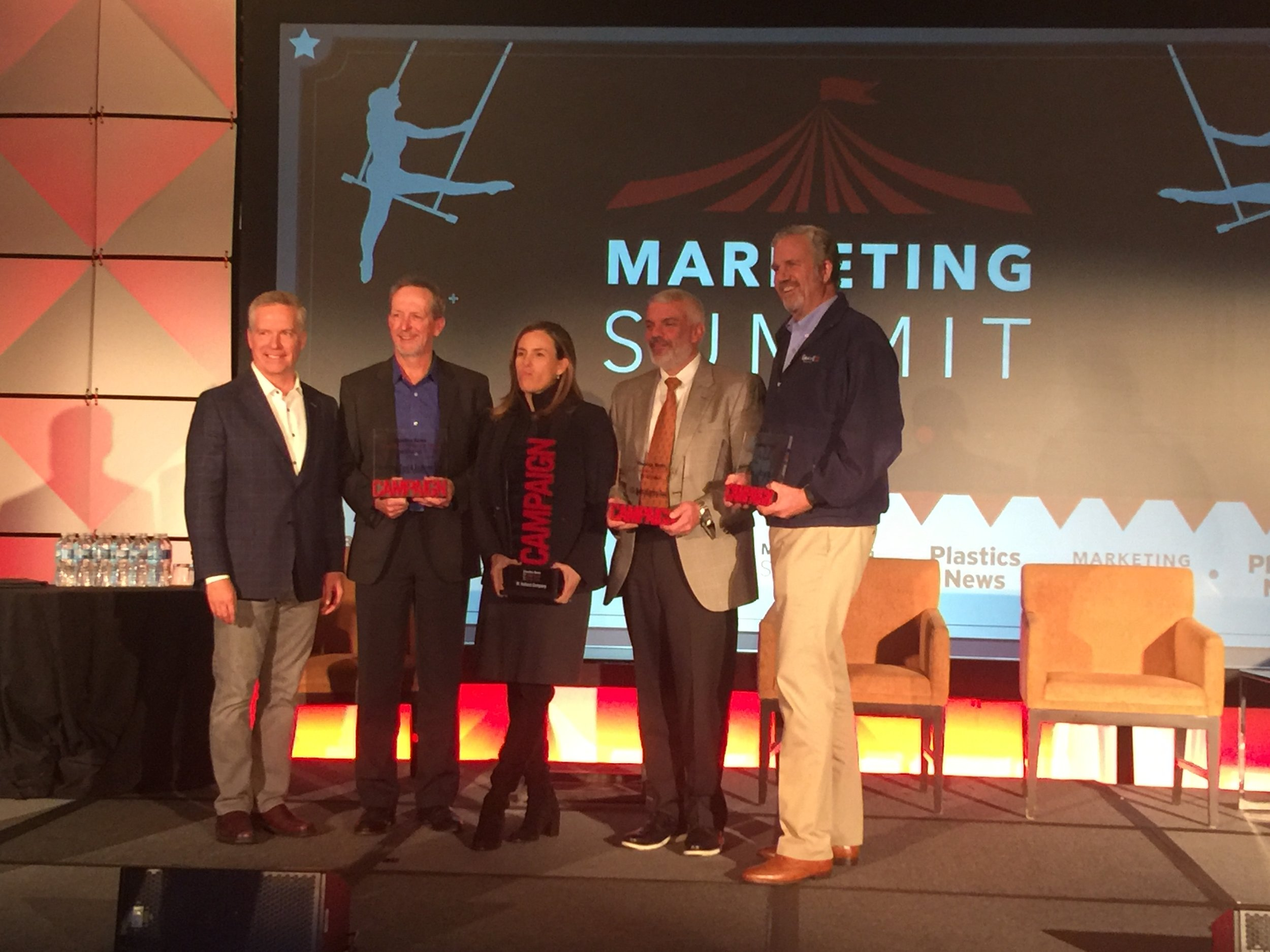 "Plastics News Publisher Brennan Lafferty (l) with the finalists for ""PN Marketing Campaign of the Year"" at the 2018 PN Marketing Summit"