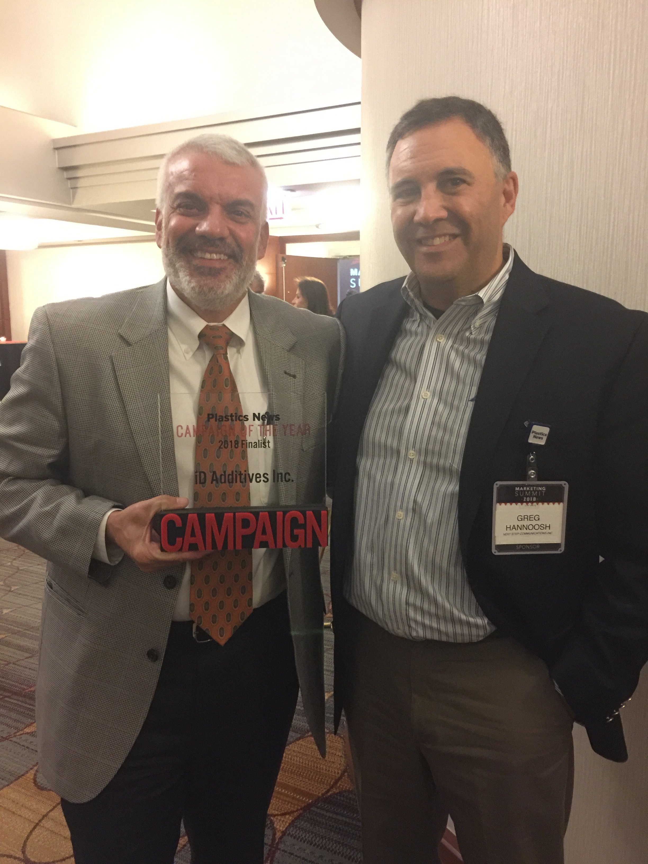 Nick Sotos (l), President of iD Additives, and Next Step President Greg Hannoosh at the 2018 Plastics News Marketing Summit
