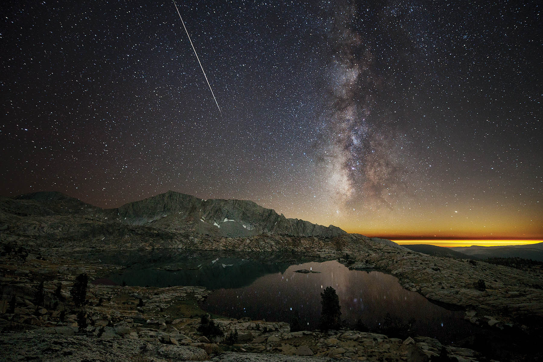 A meteor strikes over Hell For Sure Lake in the Sierra National Forest during the Perseids