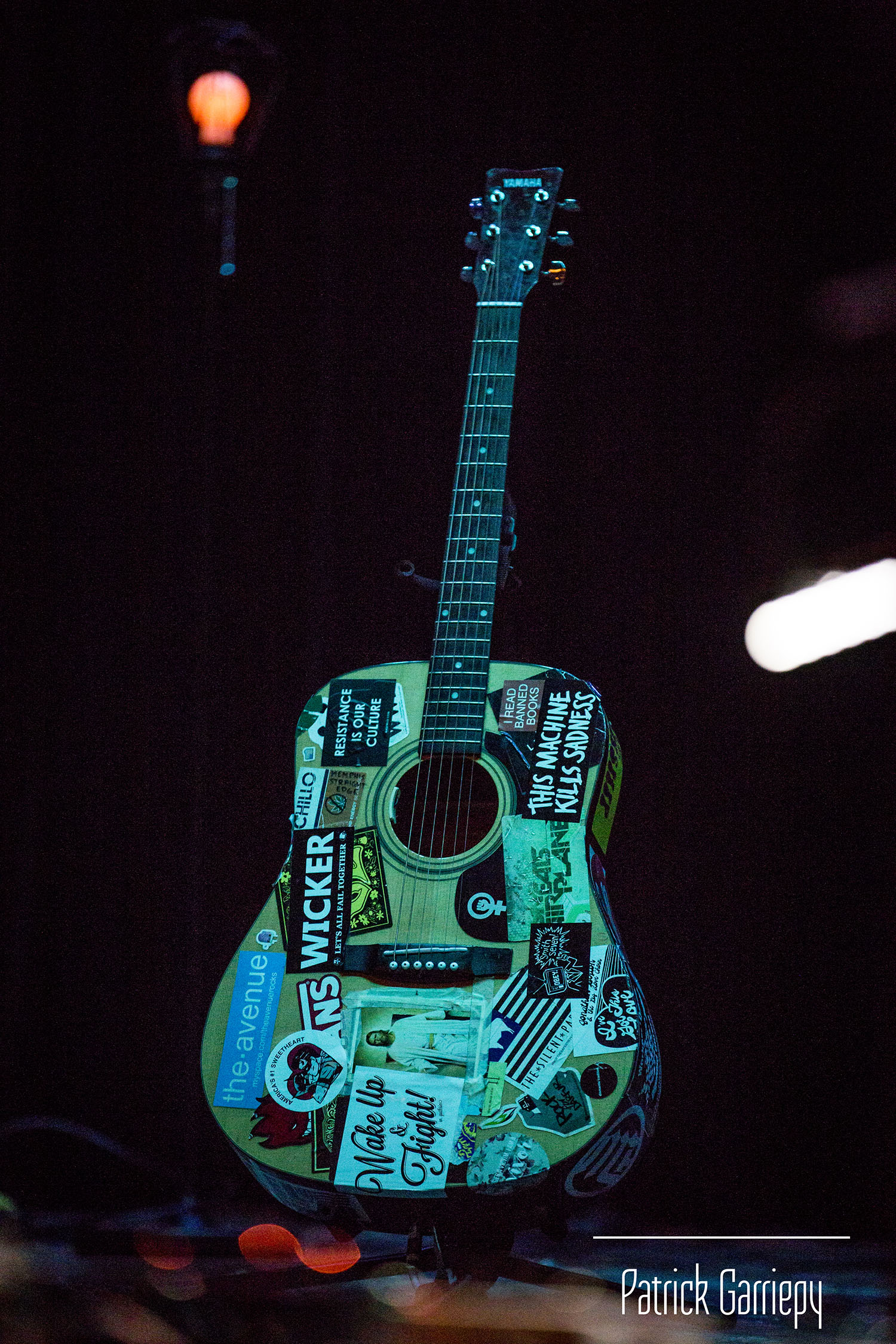 Baker's acoustic guitar on stage.