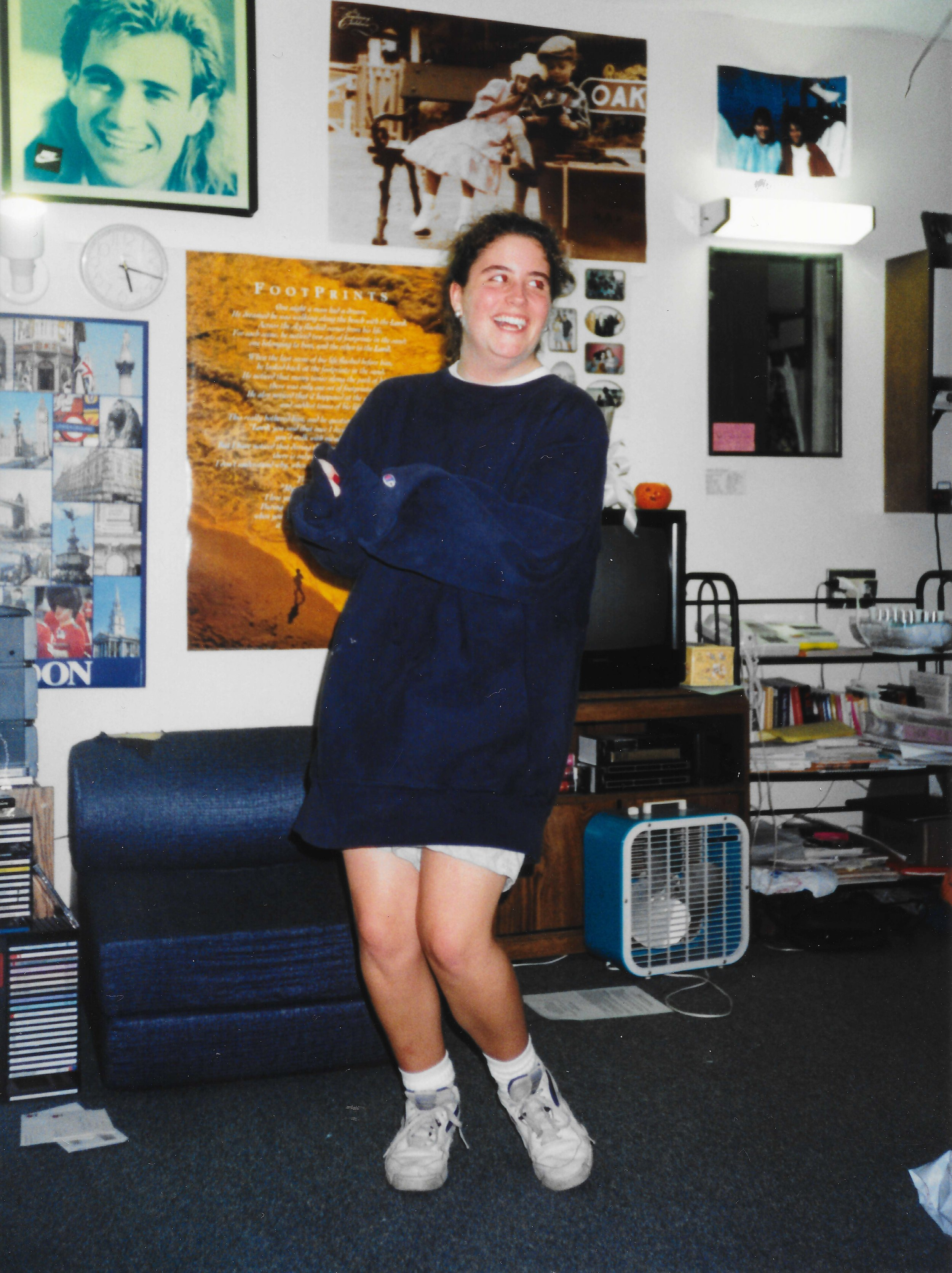Rebecca dancing back at the dorm room after winning a volleyball game … and in her over sized sweat shirt.