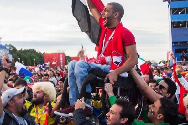 Mexican and Colombian fans lift Egyptian fan up so he can support his team!