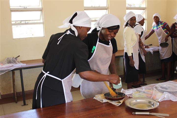 Students-Otillia-Bunjira-and-Vimbai-Thatope-taking-part-in-the-catering-class-at-Domboshawa-Mobile-Skills-Training-Zim.jpg