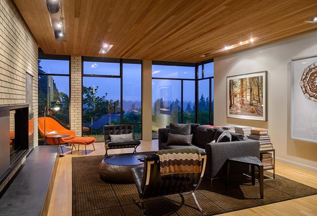 """House of Planes living room with """"Basement"""" photo by Isaac Layman and """"Abandoned Shack H"""" by Erik Johnson (on the left). . . . . . #archinect #seattlearchitects #architizer #pnwarchitecture #dezeen #dwell #modernhome #modernhouse #houzz #graymagazine"""