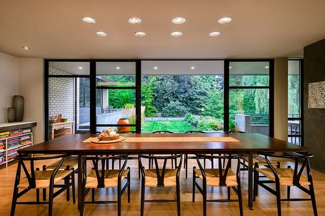 House of Planes dining room with sliding doors to south terrace.  Art by Mathew Picton.  Construction by Joseph McKinstry Construction Company. . . . . . #archinect #seattlearchitects #architizer #pnwarchitecture #dwell #dezeenmagazine #modernhome #interiordesign