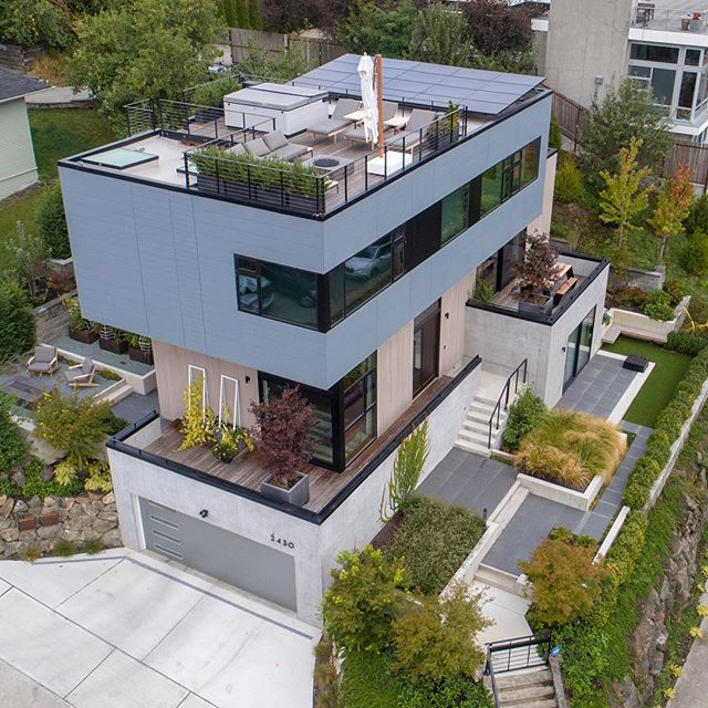 Our recently completed Mad Valley House is a collection of stacked and staggered volumes on the hillside. . . . . . #archinect #seattlearchitects #architizer #dezeen #pnwarchitecture #modernhome #graymagazine #dwell