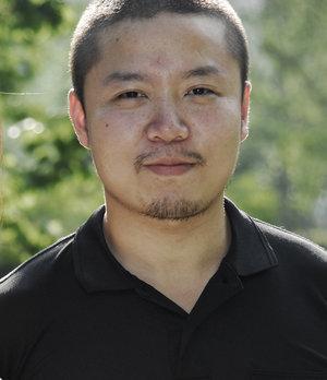 tuo-wang-headshot.jpg