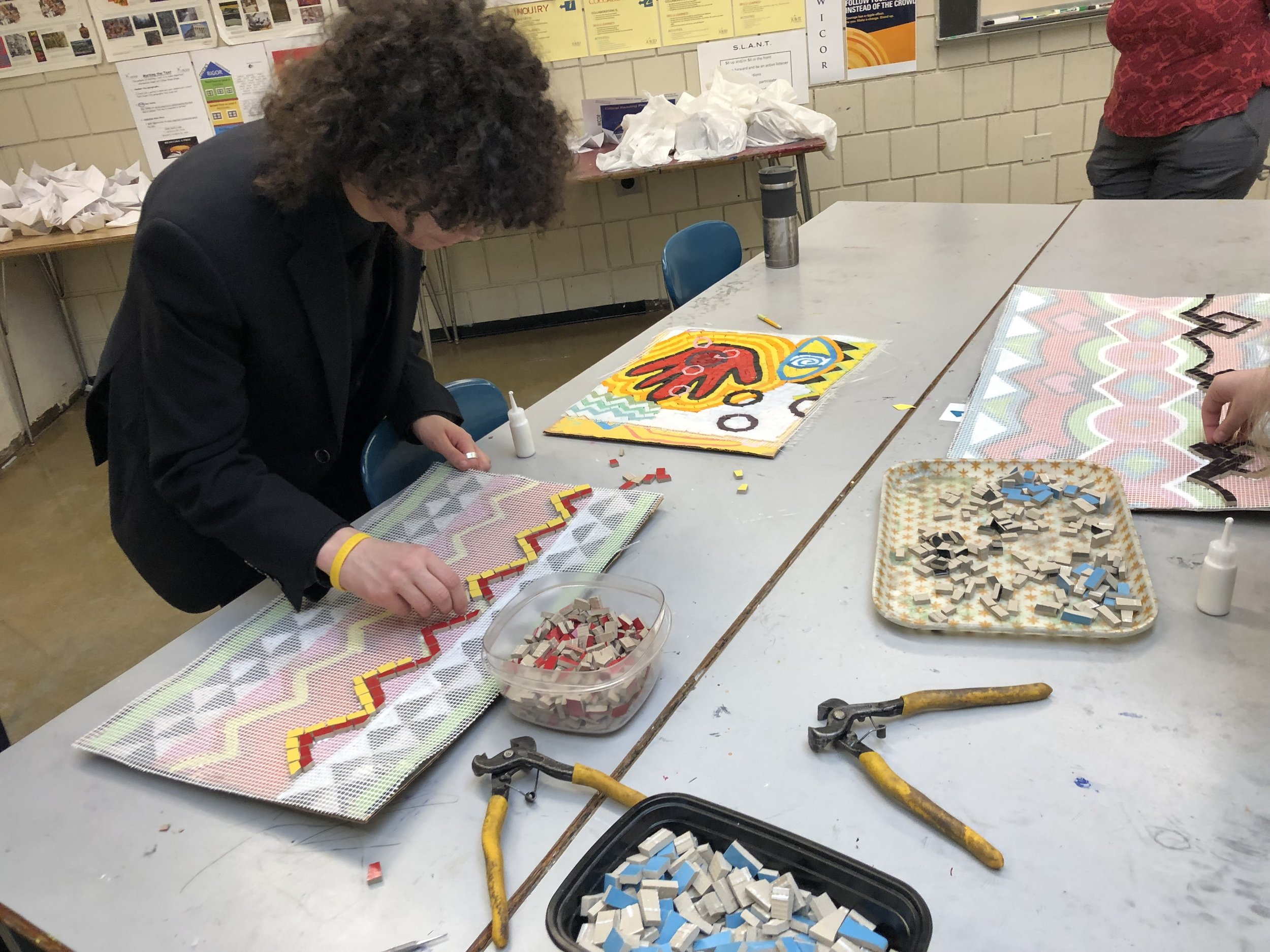 Students at Roseville Area Middle School work on the mosaic project.