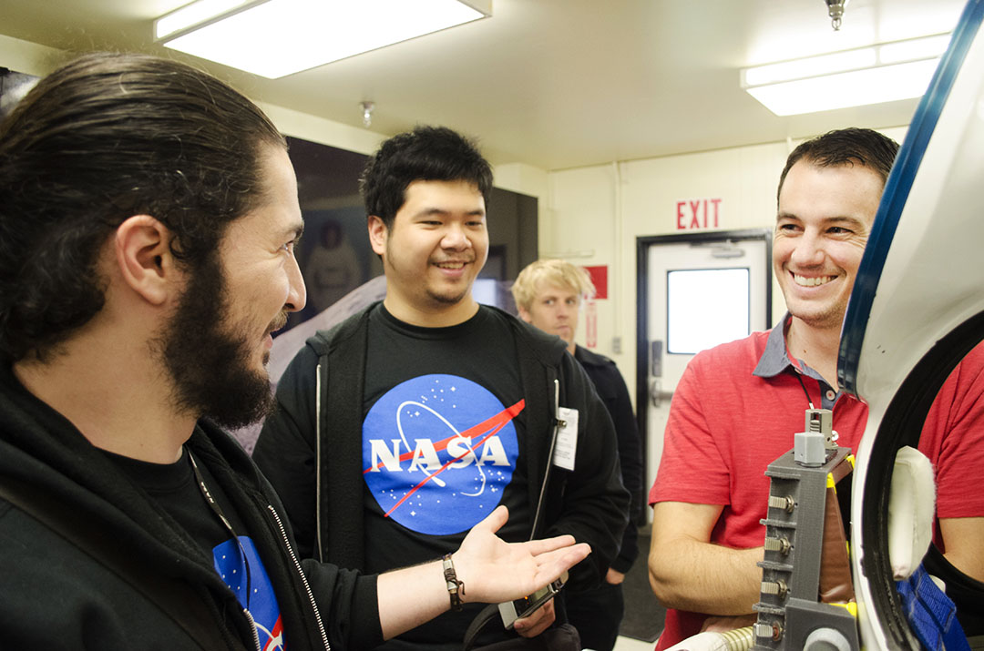 Team speaking to folks from Advanced Suit Lab (we said something smart!).jpg