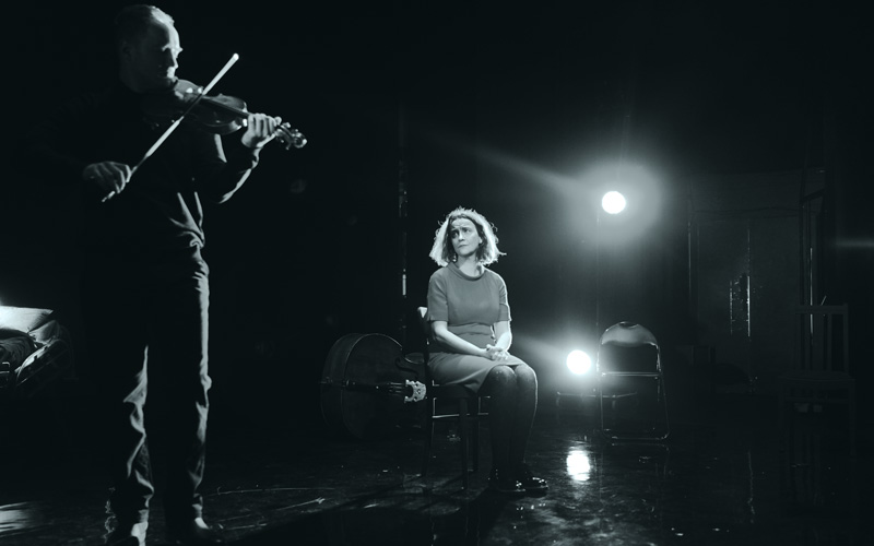 Pauline Goldsmith face is full of emotion as violinist Daniel Pioro snakes around her on stage during a performance of Arvo Part's Fratres.