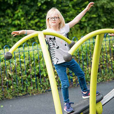 Girl playing on playground equipment in Heaton Close.jpg
